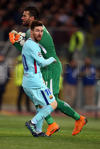 10th April 2018, Stadio Olimpico, Rome, Italy; UEFA Champions League football, quarter final, second leg; AS Roma versus FC Barcelona; goalkeeper Alisson Becker of AS Roma makes a save against Lionel Messi of Barcelona