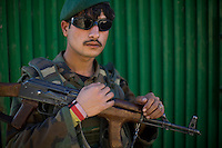 An Afghan National Army soldier guards a Shura meeting between soldiers from Delta-4, 1-26 Infantry and village elders from Shilam in the Pesh Valley. Delta-4, 1-26 Infantry visited elders in the village to hand out humanitarian aid via the Afghan National Army and maintain support in this pro-coalition village in a pro-Taliban area.