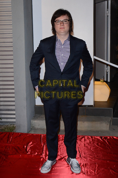 Clark Duke.'The Office' Series Finale Wrap Party held at Unici Casa Gallery, Culver City, California, USA, 16th March 2013..full length navy blue suit hands in pockets glasses gingham shirt purple .CAP/ADM/TW.©Tonya Wise/AdMedia/Capital Pictures.