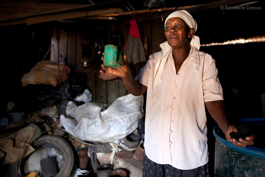 Jane Neseka, a 50 year old Kenyan, at the Gatina Busaa Club in a Nairobi slum on March 27, 2013. Jane has been brewing Busaa for more than 20 years, she opened the Gatina Busaa Club in 1986. Busaa is made by crudely fermenting maize, millet, sorghum or molasses. At Kshs 35 per liter it is much cheaper than a Kshs120 half-liter bottle of commercial beer. The local brew was legalised in 2010 and since then busaa clubs have become increasingly popular. Drinking is on the rise in Kenya, especially among young people. Photo: Benedicte Desrus
