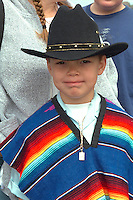 Cinco de Mayo parade spectator with black hat age 11.  St Paul Minnesota USA
