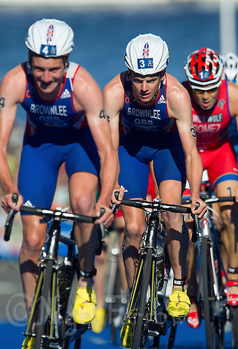 25 AUG 2013 - STOCKHOLM, SWE - Jonathan Brownlee (GBR) (centre) of Great Britain drafts his brother Alistair Brownlee (GBR) (left) on the bike during the men's ITU 2013 World Triathlon Series round in Gamla Stan, Stockholm, Sweden (PHOTO COPYRIGHT © 2013 NIGEL FARROW, ALL RIGHTS RESERVED)