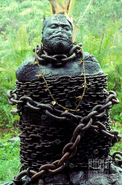 Lava sculpture of Hawaiian in bondage/chains in Puna on the Big Island of Hawaii.