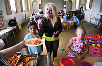 Pictured: Young familes are served hot food at St Teilo Church in Clase, Swansea, UK. Friday 25 August 2017<br /> Re: Free food for children story, Swansea, Wales, UK.