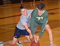 RICK PECK/SPECIAL TO MCDONALD COUNTY PRESS John Howard (right) holds off Pierce Harmon during a rebound drill at a basketball camp held June 13-15 at McDonald County High School. The camp was the first organized drills for the Mustangs under new coach Brandon Joines.