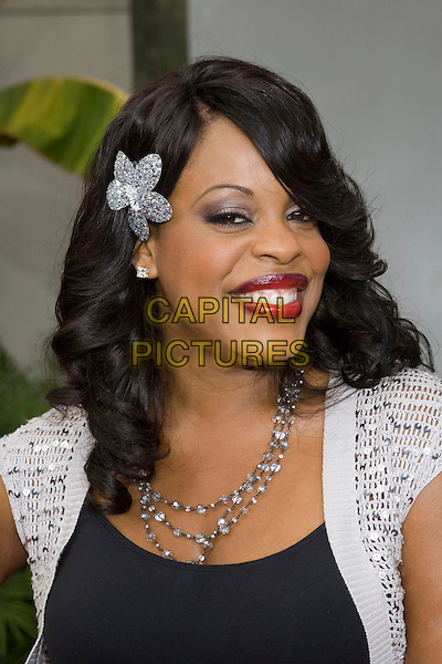 "NIECY NASH.At the ""Hustle & Flow"" Los Angeles Film Premiere,.held at the Arclight Cinerama Dome, .Hollywood, California, USA, 20th July 2005..portrait headshot flower hair clip grip hair accessory red lipstick.Ref: ADM.www.capitalpictures.com.sales@capitalpictures.com.©Zach Lipp/AdMedia/Capital Pictures."