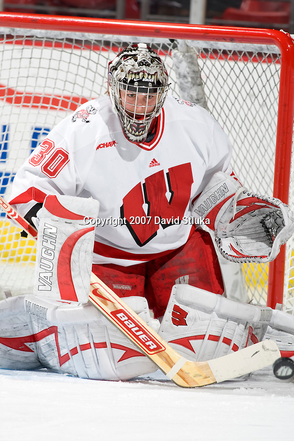 MADISON, WI - DECEMBER 1: Goalie Jesse Vetter #30 of the Wisconsin Badgers women's hockey team makes a save during warmups prior to the game against the Minnesota Duluth Bulldogs at the Kohl Center on December 1, 2007, in Madison, Wisconsin. The Bulldogs beat the Badgers 3-2. (Photo by David Stluka)