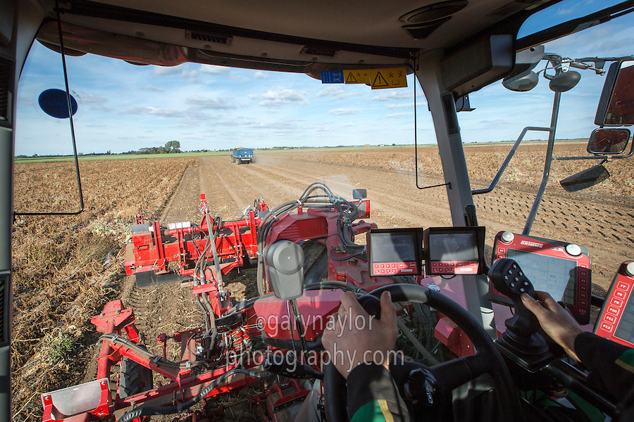In-cab view operating a Grimme Varitron 270 self propelled potato harvester