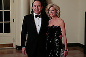 Philippe Dauman, chief executive officer of Viacom Inc., left, and Deborah Dauman arrive to a state dinner hosted by U.S. President Barack Obama and U.S. First Lady Michelle Obama in honor of French President Francois Hollande at the White House in Washington, D.C., U.S., on Tuesday, Feb. 11, 2014. Obama and Hollande said the U.S. and France are embarking on a new, elevated level of cooperation as they confront global security threats in Syria and Iran, deal with climate change and expand economic cooperation. <br /> Credit: Andrew Harrer / Pool via CNP
