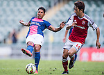 Robson Augusto Ka Hai of Kitchee (L) being followed by Yuto Nakamura of SCAA (R) during the HKFA Premier League between South China Athletic Association vs Kitchee at the Hong Kong Stadium on 23 November 2014 in Hong Kong, China. Photo by Aitor Alcalde / Power Sport Images