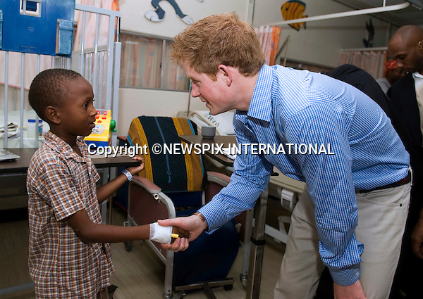 "PRINCE HARRY .with Tyrell Richards whom he met when he visited The Queen Elizabeth ll Hospital in Bridgetown, Barbados_30/01/2010.Mandatory Credit Photo: ©DIAS-NEWSPIX INTERNATIONAL..**ALL FEES PAYABLE TO: ""NEWSPIX INTERNATIONAL""**..IMMEDIATE CONFIRMATION OF USAGE REQUIRED:.Newspix International, 31 Chinnery Hill, Bishop's Stortford, ENGLAND CM23 3PS.Tel:+441279 324672  ; Fax: +441279656877.Mobile:  07775681153.e-mail: info@newspixinternational.co.uk"