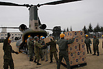 March 15, 2011, Koga Camp, Ibaragi Prefecture, Japan - Japanese Self Defense Forces load relief food aid onto a helicopter bound for areas hit hard by the Tohoku-Kanto Natural Disaster. (Photo by Mainichi Newspaper)....