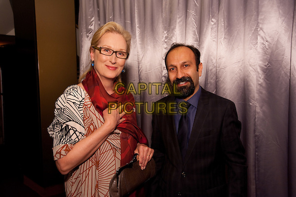 "Oscar winner Meryl Streep and Asghar Farhadi, director of the Oscar®-nominated film ""A Separation"" in the Foreign Language Film Award category for the 84th Academy Awards attend a reception in the Grand Lobby of the Samuel Goldwyn Theater in Beverly Hills, CA on Friday, February 24, 2012.  The 84th Academy Awards® will be presented on Sunday, February 26, 2012, at the Hollywood & Highland Center®, and televised live by the ABC Television Network..* Editorial Use Only*.oscars  half length glasses red scarf black suit beard facial hair .CAP/A.M.P.A.S./NFS.©A.M.P.A.S. Supplied by Capital Pictures."