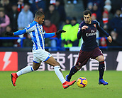 9th February 2019, The John Smith's Stadium, Huddersfield, England; EPL Premier League football, Huddersfield versus Arsenal; Henrikh Mkhitaryan of Arsenal takes on Juninho Bacuna of Huddersfield Town