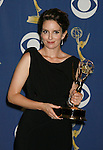LOS ANGELES, CA. - September 20: Actress Tina Fey poses in the press room at the 61st Primetime Emmy Awards held at the Nokia Theatre on September 20, 2009 in Los Angeles, California.