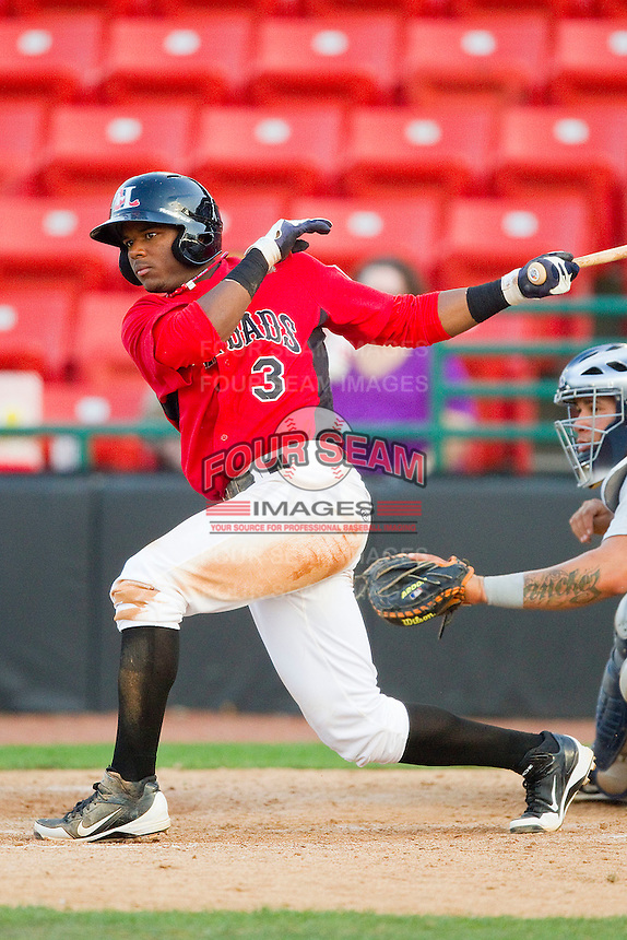 Hanser Alberto #3 of the Hickory Crawdads follows through on his swing against the Charleston RiverDogs at L.P. Frans Stadium on April 29, 2012 in Hickory, North Carolina.  The Crawdads defeated the RiverDogs 12-3.  (Brian Westerholt/Four Seam Images)