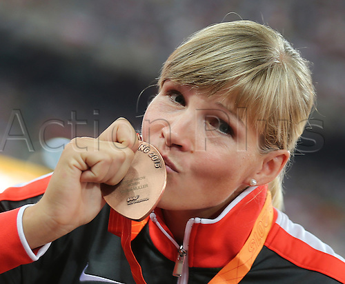 25.08.2015. Beijing, China.  Nadine Mueller ofGermany poses with her bronze medal after the women's Discus Throw final of the Beijing 2015 IAAF World Championships at the National Stadium, also known as Bird's Nest, in Beijing, China, 25 August 2015.