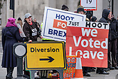 Diversion.  Pro Brexit protesters demonstrate outside the Houses of Parliament on the day MPs voted decisively to reject Theresa May's withdrawal deal with the EU.  Westminster, London.