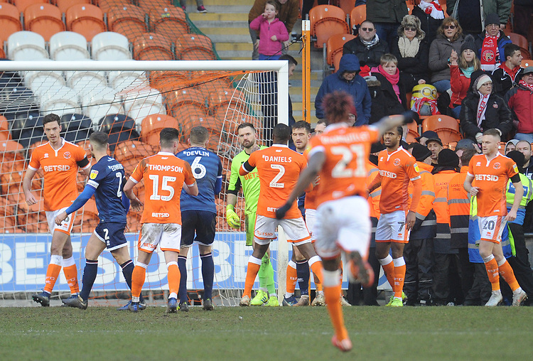 Blackpool's Mark Howard is swarmed by team-mates after saving Walsall's Matthew Jarvis (not in picture) <br /> <br /> Photographer Kevin Barnes/CameraSport<br /> <br /> The EFL Sky Bet League One - Blackpool v Walsall - Saturday 9th February 2019 - Bloomfield Road - Blackpool<br /> <br /> World Copyright &copy; 2019 CameraSport. All rights reserved. 43 Linden Ave. Countesthorpe. Leicester. England. LE8 5PG - Tel: +44 (0) 116 277 4147 - admin@camerasport.com - www.camerasport.com