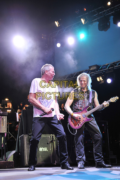 Ian Gillan and Steve Morse.Deep Purple performing live in concert, o2 Arena, Greenwich, London, England. 30th November 2011.on stage gig performance performing music full length sleeveless top  black jeans denim guitar white t-shirt profile .CAP/MAR.© Martin Harris/Capital Pictures.