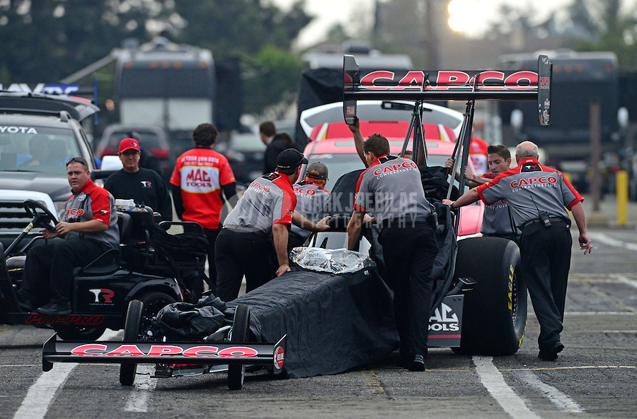 Nov. 8, 2012; Pomona, CA, USA: Crew members for NHRA top fuel dragster driver Steve Torrence during qualifying for the Auto Club Finals at at Auto Club Raceway at Pomona. Mandatory Credit: Mark J. Rebilas-