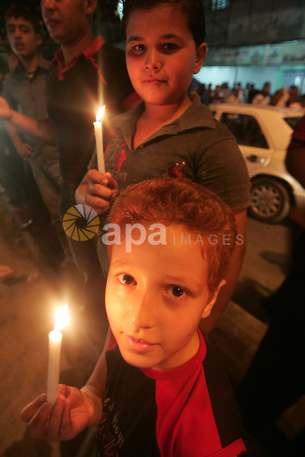 Palestinians light candles during a rally in the southern Gaza Strip on August 31,2010 as they mark the ninth anniversary to assassination of the leader of the Popular Front for Liberation Palestine, Abu Ali Mustafa Photo by Khaled Khaled