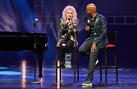 """The singer Cyndi Lauper (L) and the moderator Yared Dibaba speak on stage of the Operettenhaus during a press showing of the musical """"Kinky Boots"""" in Hamburg, Germany, 28. September 2017. The Germany premiere will be on the 3rd of December. Photo: Georg Wendt/dpa /MediaPunch ***FOR USA ONLY***"""