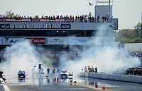 Sept. 29, 2012; Madison, IL, USA: NHRA pro stock drivers Jason Line (left) and Allen Johnson do their burnouts during qualifying for the Midwest Nationals at Gateway Motorsports Park. Mandatory Credit: Mark J. Rebilas-