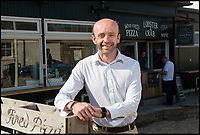 BNPS.co.uk (01202 558833)<br /> Pic: TomWren/BNPS<br /> <br /> Cliff Payne, general manager of the Watch House Cafe.<br /> <br /> While the whole country has been enjoying the final series of TV drama Broadchurch, no one is relishing the show more than the businesses of West Bay.<br /> <br /> The 'Broadchurch effect' has sent visitor numbers to the sleepy Dorset town, where the show is set, skyrocketing in the past four years.<br /> <br /> And the latest, and final, series, which finishes on Monday, has only fanned the flames, with a host of new businesses benefiting from their association with the show.<br /> <br /> Tourism organisation Visit Dorset has experienced an increase of 133 per cent in enquries and bookings on its website.<br /> <br /> Local businesses which feature on screen have also seen their profits soar thanks to 'Broadies' who stop for a selfie before calling in to make a purchase.<br /> <br /> One premises in particular has been the Washingpool Farm Shop, which is Flintcombe Farm Shop run by Lenny Henry's character Ed Burnett in Broadchurch.