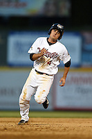 Tri-City ValleyCats shortstop Mott Hyde (4) running the bases during a game against the Batavia Muckdogs on August 2, 2014 at Joseph L. Bruno Stadium in Troy, New  York.  Tri-City defeated Batavia 8-4.  (Mike Janes/Four Seam Images)