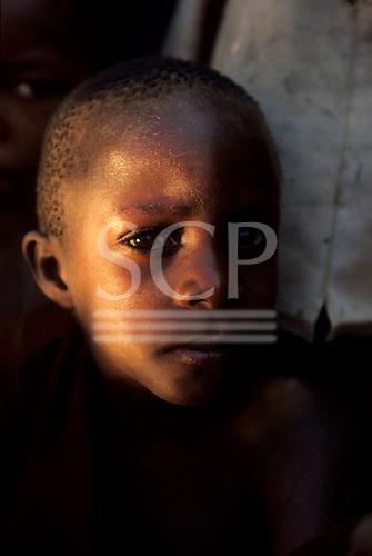 Chambesi River, Tanzania. Unsure serious looking child.