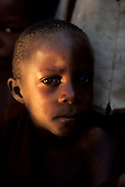 Chambesi River, Tanzania. Unsure serious looking child.