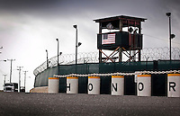 The word 'Honor' appears in front of the watchtower of Camp Delta at the American naval base at Guantanamo Bay, where over 600 alleged al Qaeda members have been held indefinitely. Described by the US as 'unlawful enemy combatants', they were captured primarily in Afghanistan during the 'war against terror'.