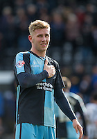 Jason McCarthy of Wycombe Wanderers at the final whistle holds the club badge during the Sky Bet League 2 match between Notts County and Wycombe Wanderers at Meadow Lane, Nottingham, England on 28 March 2016. Photo by Andy Rowland.