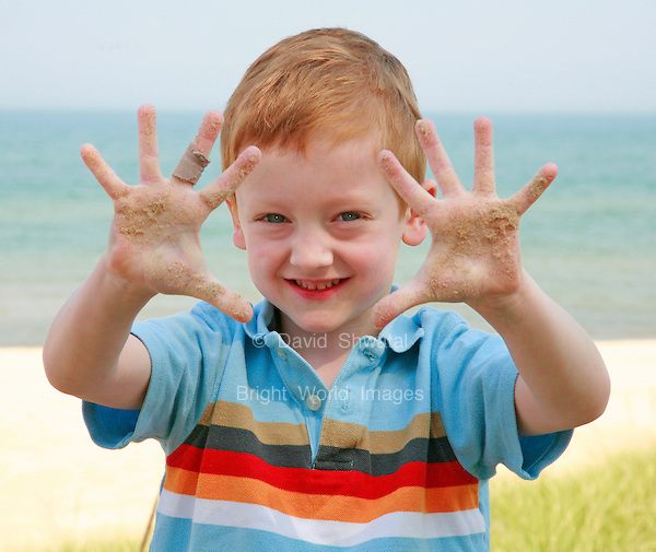 young boy showing sand on his hands at a beach. David Shwatal portrait photographer Tinley Park Chicago IL 60477