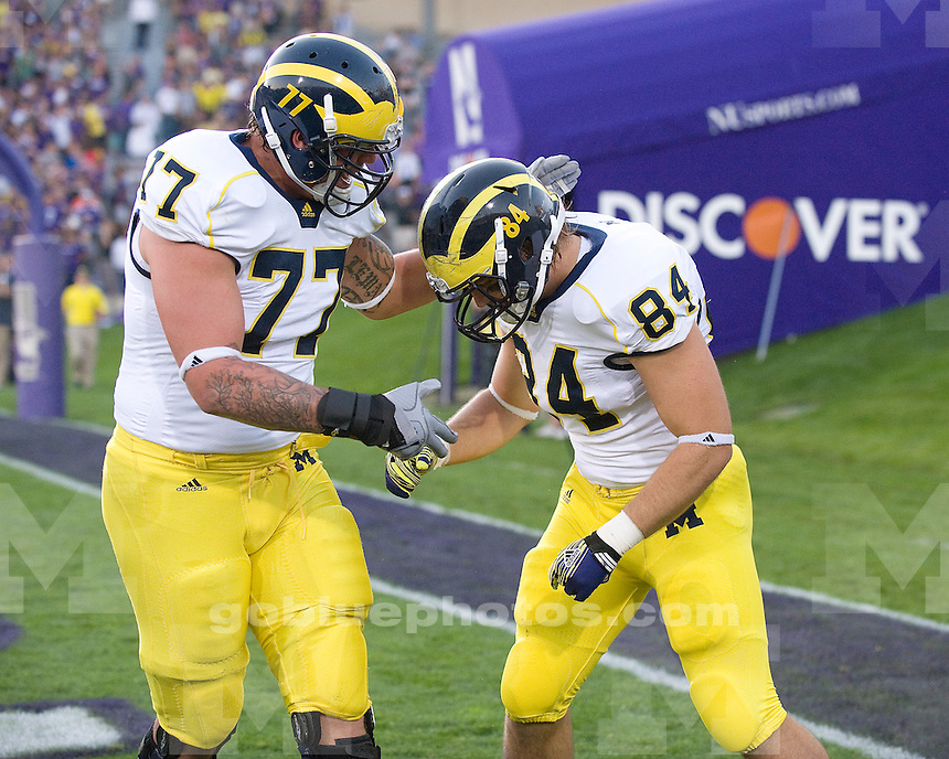 Michigan's Taylor Lewan, left, congratulates tight end Steve Watson after Watson caught a first quarter touchdown pass. The University of Michigan football team beat  Northwestern University 42-24 at Ryan Field in Evanston, Ill., on October 8, 2011.