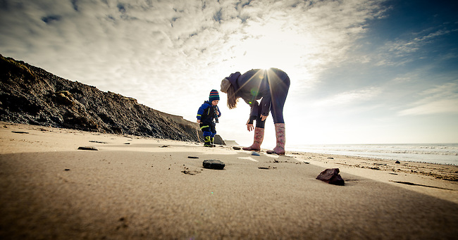 Mother and child searching for Fossils and Dinosaur remains on Compton Beach, Isle of Wight