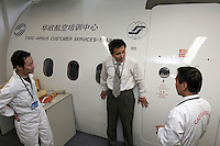 China South West Airlines' pilots are having a mock-up emergency drill with instructor in the training centre of Airbus China Ltd., Beijing, China. The two pilots are used to operate the Boeing 737 and are now trained to operate the Airbus A319..19 Jan 2005