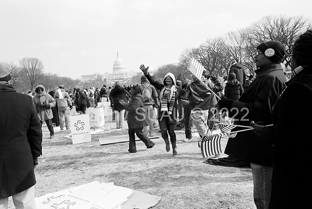 Washington DC<br /> District of Columbia<br /> USA<br /> January 20, 2009<br /> <br /> An estimated 2 million people from across the United States of America fill the capital mall under under sub-zero degree celsius weather -to attend the inauguration of the first black president of the country, Democrat Barack Obama...Dancing with pure happiness after watching and listening to the final words from the newly sworn in President Barack Obama.