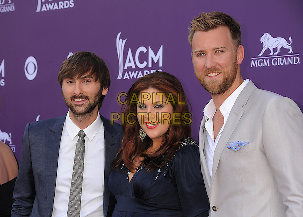 Dave Haywood, Hillary Scott, Charles Kelley of Lady Antebellum.48th Annual Academy of Country Music Awards - Arrivals held at the MGM Grand Garden Arena, Las Vegas, Nevada, USA..April 7th, 2013.ACM half length black blue dress suit grey gray beard facial hair band group .CAP/ROT/TM.©Tony Michaels/Roth Stock/Capital Pictures