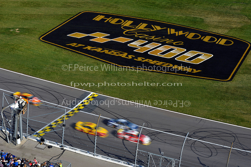 Cars speed across the start/finish line