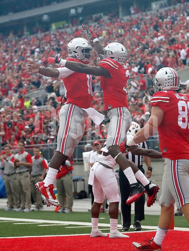 Ohio State Buckeyes quarterback J.T. Barrett (16) celebrates the touchdown with Ohio State Buckeyes wide receiver Michael Thomas (3) during the first half of the NCAA football game between the Ohio State Buckeyes and the Northern Illinois Huskies at Ohio Stadium on Saturday, September 19, 2015. (Columbus Dispatch photo by Jonathan Quilter)