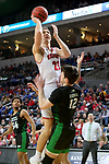 SIOUX FALLS, SD - MARCH 8: Tyler Hagedorn #25 of the South Dakota Coyotes goes up for a jump shot against Filip Rebraca #12 of the North Dakota Fighting Hawks at the 2020 Summit League Basketball Championship in Sioux Falls, SD. (Photo by Dave Eggen/Inertia)