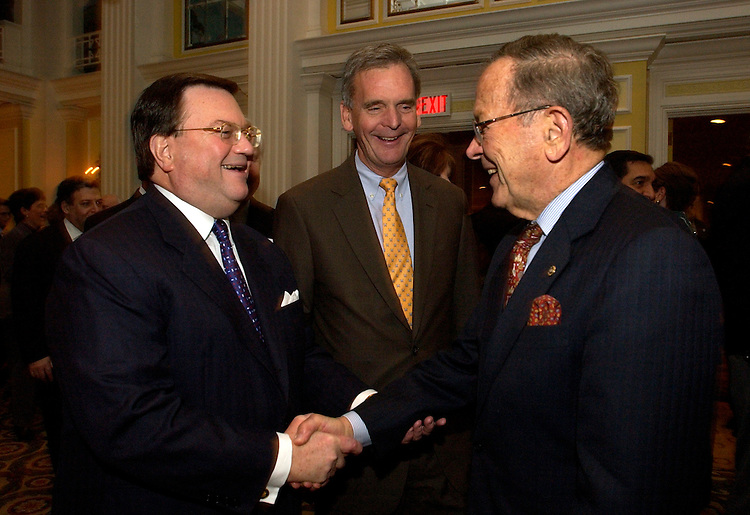 Eddie Fritts, left, greets Sen. Ted Stevens, R-Alaska, right, and Sen. Judd Gregg, R-N.H., at Fritts' retirement party held at the Willard Hotel, Tuesday.  Fritts retired as president of the National Association of Broadcasters.