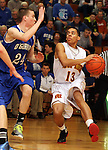 SIOUX FALLS, SD - FEBRUARY 26:  Trevon Moody #13 from Roosevelt looks to get around the defense of Connor Nagel #24 from O'Gorman in the first half of their District 1AA game Tuesday night at Roosevelt. (Photo by Dave Eggen/Inertia)