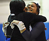 Jessica Lopez of Plainview JFK, right, gets a congratulatory hug from coach Debbie Rut after her performance on the uneven bars that earned her a score of 9.30 in the Nassau County varsity gymnastics individual championships and state qualifier at Long Beach High School on Tuesday, Feb. 13, 2018.