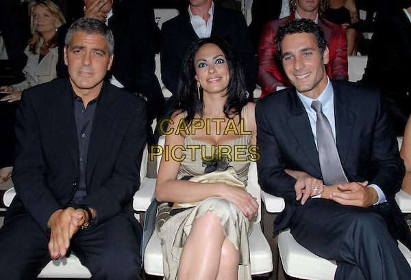 GEORGE CLOONEY, MARIA GRAZIA CUCINOTTA & RAUL BOVA.Armani's Spring-Summer 2007 men's collection, during Milan's fashion shows, Milan, Italy..June 28th, 2006 .Ref: OME.half length blue suit jacket black sitting .www.capitalpictures.com.sales@capitalpictures.com.© Capital Pictures.