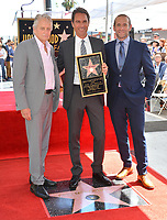 """LOS ANGELES, CA. September 13, 2018: Michael Douglas, Eric McCormack & Max Mutchnick at the Hollywood Walk of Fame Star Ceremony honoring """"Will & Grace"""" star Eric McCormack."""