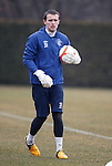 Goalkeeper Alan Smith in the practice nets after saving shots from coach Jim Stewart and first choice stpper Neil Alexander