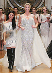 Fashion designer Karen Sabag, walks runway with models for the close of her Karen Sabag 2015 Bridal Collection fashion show at Burden Mansion, during New York Bridal Fashion Week Spring 2015.